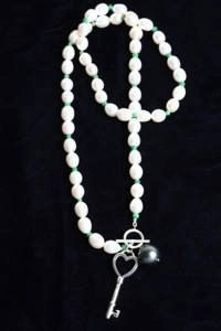 white fresh water pearls with emerald beads. by AccessorySalad