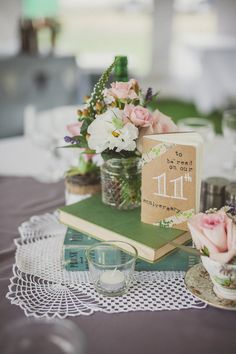 so cute.. homemade books at each table that are blank for guests to write in and then read on a certain anniversary