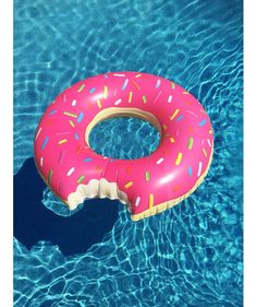 Jump in the pool with the Giant Strawberry Donut Pool Float Partially bitten, with pink icing and multi-colored sprinkles, this sweet treat is sure to bring sugar to your pool party!