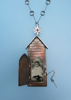 Dana Stenson Jewelry and Metalwork, locket in copper and sterling with sapphire