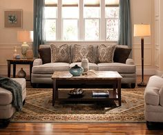 Grey Couch Tan Walls Cream Ottoman And Carpet For The