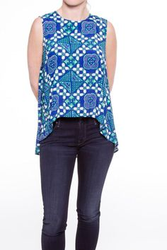 A printed top with round neckline, soft pleated detail at back, and high-low cut. The high-low hem is very exaggerated; a simple high-waisted jean or skirt is the best complement to this graphic top.   Sleeveless High-Low Top by Sea New York. Clothing - Tops - Sleeveless Vail, Colorado