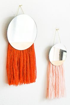Can't get enough of the wall hang trend? Neither can we! Check out this super cute DIY Fringed Mirror Wall Hanging that's so perfect for Fall...