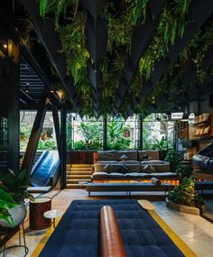 """Dezeen on Instagram: """"Verdant greenery contrasts with the concrete benches and grey metal walls of this hotel in Medellín, Colombia, designed by Plan:b…"""" Colombian Cities, Metal Room Divider, Mug Design, Concrete Bench, Plant Covers, Inspiration Design, Types Of Rooms, Cover Gray, Hotel Lobby"""