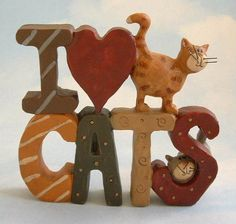 (via BLOSSOM BUCKET PRIMITIVE FOLK ART I LOVE CATS Grey  Orange Tabby Cat FIGURINE | eBay)