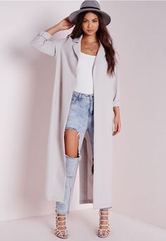 We're vibin all over this long line grey maxi duster jacket this season here at Missguided. With luxe long sleeves, pockets to the hips and seriously smokin' kick split to reverse this coat will ensure all eyes are on you! Style this on...