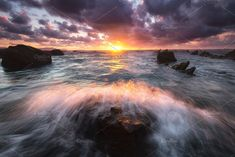 Wave splashing in a rock at Barrika by PhotoNature on @creativemarket