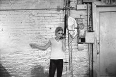Edie Sedgwick using the only telephone in the Factory. From Factory Andy Warhol Stephen Shore. 1965-7 © Stephen Shore