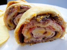 Baked Club Pinwheels    6 slices pre-cooked bacon, chopped   1 (11-oz.) can Pillsbury® Refrigerated Crusty French Loaf   1 cup shredded sharp Cheddar cheese   5 slices thinly sliced deli turkey   5 slices thinly sliced deli ham   5 slices thinly sliced deli roast beef