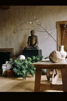#zen #fengshui #serene #naturalwood Simple natural wood tables and stands, when teamed with live plants and asian sculptures, yield a peaceful, zen-like ambiance