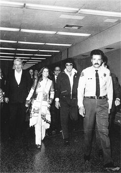Elvis and Priscilla leaving Santa Monica Superior court in California after being granted a divorce; they were married for six years.