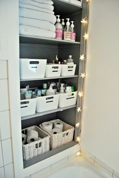 perfect linen closet storage // love the bins for everything. // update: found the bins at IKEA. They are $7.99 a piece for the large and $6.99 for small