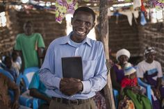 Pastor William Kenga stands inside Biyubu Soul Harvest Church that Samaritan's Purse helped construct.