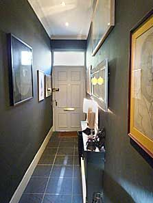 Design:  Narrow entryway...like dark gray paint, artwork, thin table and pendants.