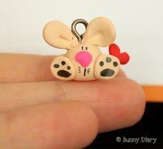 Tiny Bunny with a heart charm clay figurine by BunnyDiary on Etsy, $18.00