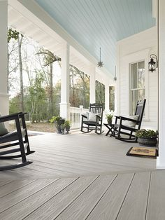 LOVE, love, love deep porches with blue ceilings. Ours would be glass enclosed. Moravian stars are a nice touch too. If we can't have concrete floors, composite would be better than wood. Farmhouse Front Porches, House, Front Porch Decorating, Synthetic Decking, House Exterior, Decks And Porches, Backyard Retreat, Porch Design, Porch Flooring