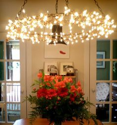 """Hmmm.... struggle to decide if this is just for the holidays or everyday!  I might just love this idea for a dark corner in my house.  The more I think about it wouldn't it be GREAT outdoors???  The chandelier is formed with a floral wire wreath form.  It could be wrapped with lights and hung inside your patio umbrella.  Lots of possibilities for this """"chandelier""""!!!"""