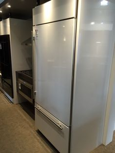 Sub Zero Bottom Mount Refrigerator With Custom White Door Panels At Universal  Appliance And Kitchen