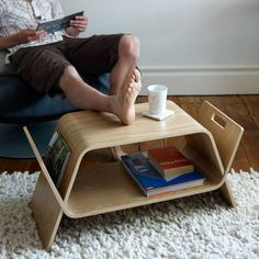 Embrace is an award winning piece of furniture, designed to store modern media such as DVDs, CDs, books and magazines. This smart piece of furniture naturally forms two low modern tables that are then embraced together in order to form a storage unit / magazine rack / occasional table. While apart the small tables also function well as a laptop table, a bench and desk for kids ... or even as serving tray for breakfast in bed. Dimensions: 375mm h X 850 mm w X 350 mm d Designer: John Green…