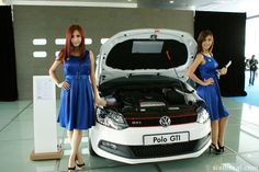 Girls posing with a white Volkswagen Polo GTI #babe #babes #VW #Lady #Ladies #Model #Models