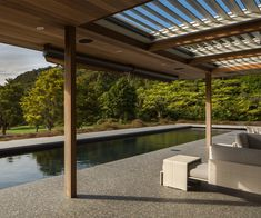 A Northland pool lined in glossy black tiles - Homes To Love