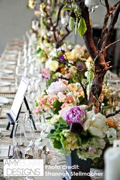 This kings table is spectacular! Low centerpieces placed on manzanita trees with hang in candles. Beautiful. @ShanStellmacher #whimsical
