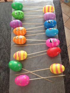 Plastic Easter eggs on skewers for yard decoration..drill a small hole in the bottom of the eggs just big enough for a skewer, then use hot glue to hold the skewers...when glue is dry, place hot glue around the lip of the top shell to keep the eggs from falling apart when outside