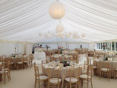 Central paper lanterns with power and then a cluster of paper lanterns over the dance floor