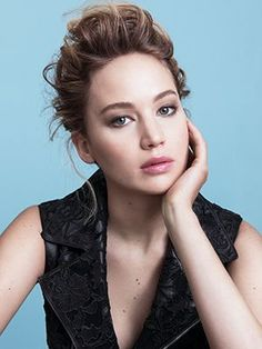 Jennifer Lawrence wispy updo with natural taupe eye makeup and glossy lips | allure.com