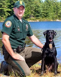 NHFG Conservation Officer William Boudreau with K9 Ruby