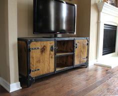 Media Console constructed of steel, wood, rivets and welded solid. Industrial style, fits any decor. Distressed and aged for vintage character.