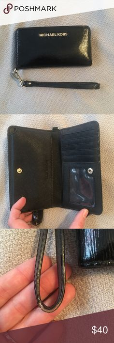 Michael Kora wristlet Black leather Michael Kora wristlet, purchased at Macy's roughly two years ago. Holds 5 cards and also a slot for your id, and has zippered change pouch on the back. At the time it fit the iPhone 5s but since upgrading to the 6 plus my phone no longer fits. There is some ware on the wrist part, shown in the third picture. Michael Kors Accessories