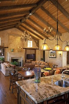 Not my style, but this is what I want. Kitchen with big island, long table, then the living room. light fixture