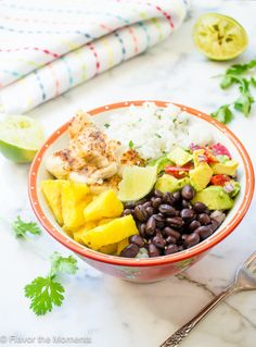 Fish Taco Bowls with Cilantro Lime Rice and Grilled Pineapple is a fresh, healthy meal that's bursting with flavor.  It will be on the table in under 40 minutes so it's perfect for busy weeknights!