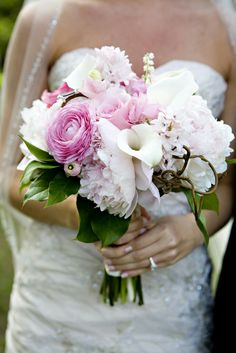 Very Elegant Bridal Bouquet Comprised Of: Pastel Pink Roses, Pink Ranunculus, Light Pastel Pink Peonies, Light Pastel Pink Hyacinth, White Calla Lilies, White Lily Of The Valley, Dried Vine + Green Foliage