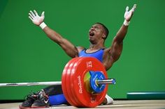 Weightlifting, Mens 62kg - Oscar Figueroa, Columbia - Rio Olympics 2016   takes off shoes and announces his retirement to the world.