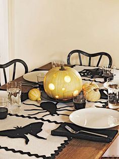 Eat, Drink, and Be Scary, A table runner embellished with critters sets the scene for fright night entertaining.
