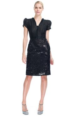 This two pocket cocktail dress is woven with actual film and features a slim front keyhole with a toggle button closure and embroidered leather floral detail at shoulders Back center zip with hook and eye closure 49% cotton, 43% viscose, 8% polyester Fully lined in silk