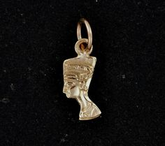 This is a one in a series of charms Ive made in both sterling silver and antique bronze that are 1cm long. This one is of Nefertiti, the famous