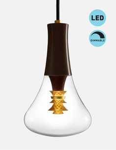 Just Launched in the MoMA Design Store in NYC! Plumen 003 Dimmable LED Pendant Set. The 003 has been describes as a craft bulb because a fine art jeweler designed the golden element. See the whole Plumen range at http://www.plumen.com