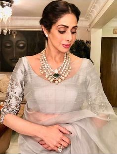 The beautiful #grey #saree gets a lift with #kundan necklace. Simple yet royal. Totally love this.