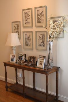 Love the framed pictures behind this table--not so much the table setting.