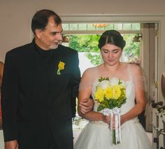 Weddings Yellow Flowers Sharon, MA Bride walking down the aisle with dad