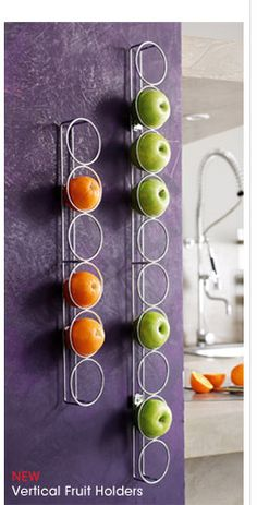 Fruit bowl turned into wall art with this vertical fruit holder for the kitchen.