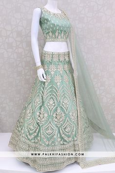 Gorgeous Light Teal Green Lehenga Set With Appealing Work & Style Light teal green designer lehenga choli set with thread,resham,petite stone & kundan work light pista net dupatta. Pakistani Lehenga, Bridal Lehenga Choli, Indian Anarkali, Ghagra Choli, Indian Sarees, Party Wear Lehenga, Party Wear Dresses, Wedding Dresses, Prom Dresses