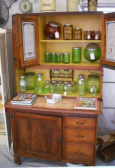 Hoosier Cabinet in a Booth at Brimfield by The T-Cozy, via Flickr