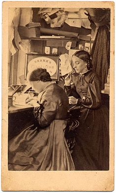 Photographer's studio..women tinting glass plates with watercolors to colorize them.