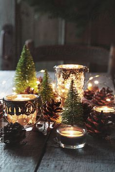 Closeup of candles and decorations for the holidays by Sandra Cunningham for Stocksy United
