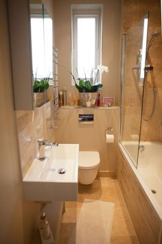 Small bathroom ideas and small bathroom designs for both city and country homes. From small bathroom designs using tile and wallpaper, to help decide on a small bathroom layout. Tiny Bathrooms, Tiny House Bathroom, Amazing Bathrooms, Comfort Room Tiles Small Bathrooms, White Bathrooms, Small Space Design, Bathroom Design Small, Small Spaces, Bathroom Designs