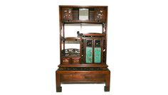 An exquisite and very rare Japanese rosewood display cabinet with finely decorated outlays of Mother of pearl and ivory. The cabinet has porcelain enamelled door panels with adjustable sliding door and sliding mirror; included are two secret drawers.                                  The cabinet is on its original stand.  C.1900 Japanese